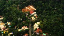 Tracking shot from a helicopter of a view of exclusive homes in a Rio de Janeiro neighborhood.
