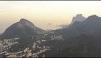 Tracking shot of the city of Rio de Janeiro nestled among its mountain range.