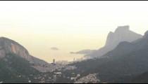 Zoom tracking shot of Rio de Janeiro between the mountains to Guanabara Bay.