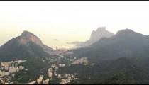 Tracking shot of Rio de Janeiro's scenery between the mountains to Guanabara Bay.