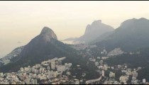 A view from a helicopter of Sugarloaf Mountain with the city of Rio de Janeiro beneath.
