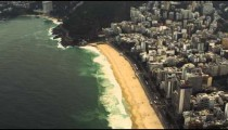 A view from a helicopter of Sugarloaf Mountain with the city of Rio de Janeiro below.