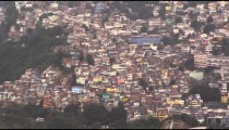 View from a helicopter of the crowded city of Rio de Janeiro far below.