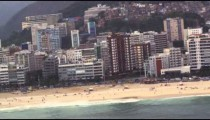 A helicopter view of Rio de Janeiro's beaches and skyscrapers.