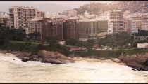 An aerial view of Rio de Janeiro's rocky beaches beaches with tall buildings.