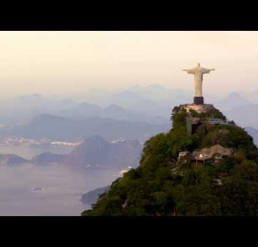Hovering aerial view featuring the Cristo Redentor in Rio de Janeiro.