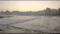 Slow motion pan from a beach in Rio de Janeiro to Atlantic Ocean.