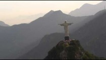 Iconic hovering helicopter shot of Cristo Redentor, front of statue, in Rio de Janeiro, Brazil.
