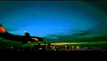Tracking shot of plane landing at night in a Brazilian airport
