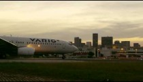 Panning shot of airplane taking off in Rio de Janeiro, Brazil