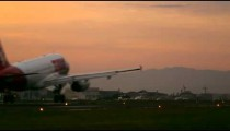 Static shot of plane landing in the early morning in Rio de Janeiro
