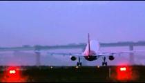 Slow pan behind a commercial plane taking off at Jacarepagu