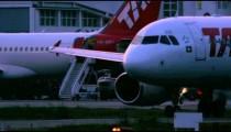 RIO DE JANEIRO, BRAZIL - JUNE 21: Close up of plane taxiing on tarmac of airport, Rio de Janeiro