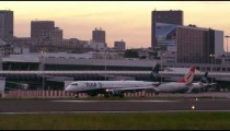 RIO DE JANEIRO, BRAZIL - JUNE 21: Static shot as plane taxis on tarmac as another leaves terminal