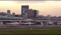 RIO DE JANEIRO, BRAZIL - JUNE 21: Small plane, taxis down runway in front of Rio cityscape