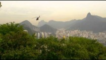 Shot of helicopter taking off and flying over Rio de Janeiro, Brazil