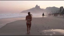 Woman jogging down Ipanema beach