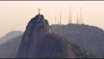 Distant shot of Christ the Redeemer statue on top of Corcovado Mountain