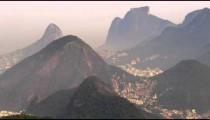 Wide static shot of Rio de Janeiro surrounded by mountains in Brazil