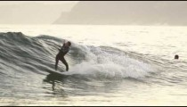 A man rides a wave in Guanabara Bay