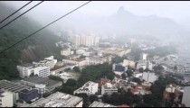 Tracking aerial shot of Rio de Janeiro, Brazil taken from a gondola