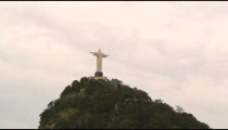 Distant tracking aerial shot of Christ the Redeemer statue in Rio de Janeiro, Brazil