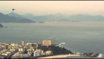Aerial pan shot of Rio de Janeiro, Brazil urbanscape and the Atlantic Ocean