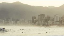 People swimming and surfing on beach