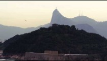 Distant tracking shot of Christ the Redeemer statue in Rio de Janeiro, Brazil