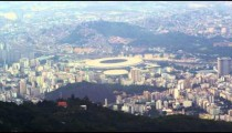 Aerial footage of Rio, football arena and mountains