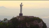 Tracking footage of Rio's Christ Redentor on hazy day