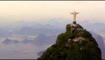 Aerial tracking footage of Christ Redentor overlooking bay