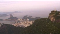 Aerial pan of city, Christ statue atop Corcovado
