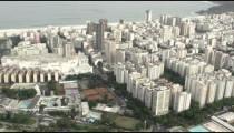 Aerial pan of waterfront skyscrapers