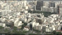 Aerial pan of waterfront buildings