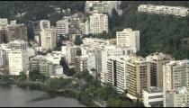 Aerial pan of lakeside buildings