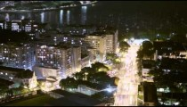 Aerial time lapse overlooking a busy street and cityscape in Rio de Janeiro, Brazil
