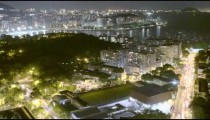 Time lapse overlooking busy streets and green hill at night in Rio de Janeiro, Brazil