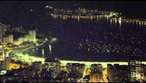 Night skyline over the water at Ipanema Beach in Rio de Janeiro